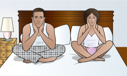 couple in bed looking upset